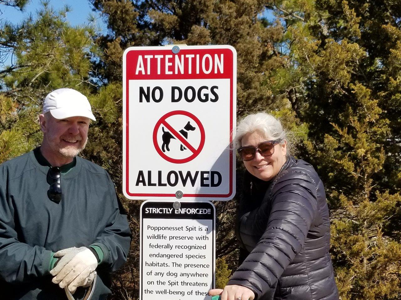 Mike Oleksak and Dawn Peterson installing No Dog Allowed signs on the Spit, at the more popular boat anchoring spots and on Audubon land.